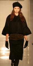 Oasis catwalk model wearing cropped sleeve coat 2006.
